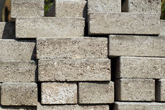 Stacked building bricks outside in sunshine Royalty Free Stock Images