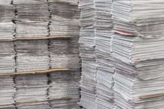 Stacked bundles of newspapers Stock Photo