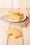 Stacked butter biscuits with sesame. In white plate on wooden background stock image