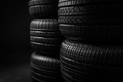 Stacked car tires on black background Stock Photo