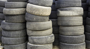 Stacked Car Wheels. Car wheels mounted in mechanical workshop, car spare parts Royalty Free Stock Photo
