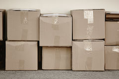 Stacked cardboard boxes. Delivery background. Copy space Stock Images