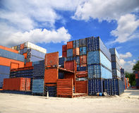 Stacked cargo containers in storage area Stock Photo