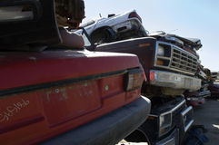 Stacked Cars In Junkyard. Obsolete cars piled up in a junkyard Stock Image