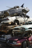 Stacked Cars In Junkyard. Stack of worn and broken�down cars at junkyard Royalty Free Stock Photo
