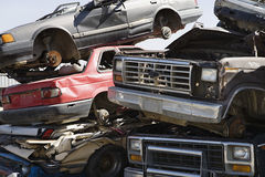 Stacked Cars In Junkyard. Stack of worn out and broken�down cars at junkyard Royalty Free Stock Image