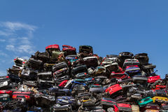 Stacked cars at a junkyard. Stacked cars in a blue sky at a junkyard in Amsterdam the Netherlands royalty free stock image