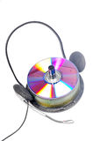 Stacked cd's and headphone Stock Images