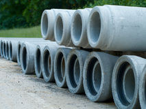 Stacked cement pipes for sewerage rehabilitation Royalty Free Stock Images