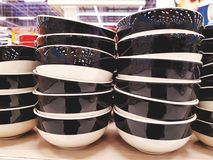 Stacked Ceramic Bowls on Shelf at the Store royalty free stock images