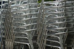 Stacked chairs. Stacked silver chairs Stock Photos
