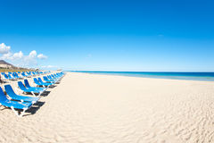 Stacked chairs on the beach on Fuerteventura Stock Image