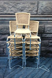 Stacked Chairs. Modern chairs, stacked and chained Royalty Free Stock Photo