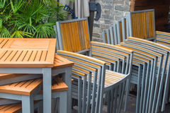 Stacked chairs and tables. Stacked spare chairs and tables Stock Photography