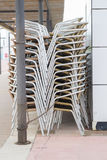 Stacked chairs. Terrace chairs stacked in the street Royalty Free Stock Images