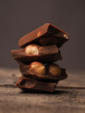 Stacked chocolate bars. Close up of stacked chocolate bars on a wooden table Stock Photography