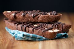 Stacked Chocolate Biscotti on Wood with Black Background Closeup Royalty Free Stock Photography