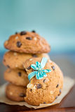 Stacked chocolate chip cookies with blue ribbon Royalty Free Stock Photography