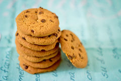 Stacked chocolate chip cookies on blue table set Royalty Free Stock Image