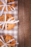Stacked chocolate chip cookies on wooden table Stock Images