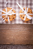 Stacked chocolate chip cookies on wooden table Royalty Free Stock Photo