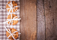 Stacked chocolate chip cookies on wooden table Royalty Free Stock Image