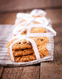 Stacked chocolate chip cookies on wooden table Royalty Free Stock Photos