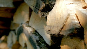 Stacked chopped firewood. Chopped firewood on a stack. Shabby wooden pieces stock video