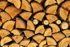 Stacked chopped wood for the winter or construction as background Stock Photos