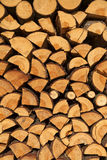 Stacked chopped wood for the winter or construction as background Stock Photography