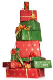 Stacked christmas gifts. High up tower of red and green christmas presents Royalty Free Stock Image