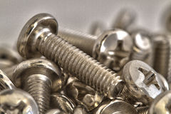 Stacked of chrome bolts Royalty Free Stock Image