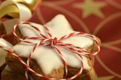 Stacked cinnamon stars packed with red and white ribbons Stock Images