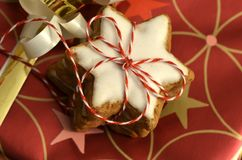 Stacked cinnamon stars packed with red and white ribbons Stock Image