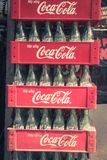 Stacked Coca Cola Box and empty bottles in Bangkok Thailand stock photography