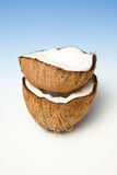 Stacked coconut halves Stock Photos