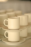 Stacked coffee cups. A stack of porcelain cups, shallow depth of field, warm colour filtering Royalty Free Stock Image