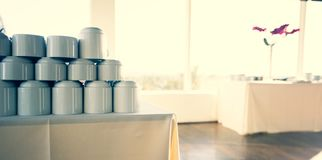 Stacked Coffee Mugs. A image of stacked coffee mugs set for a morning meeting break royalty free stock images