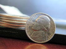 Stacked Coins. American Quarters stacked next to an American nickel in the foreground Royalty Free Stock Photos