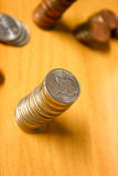 Stacked Coins. Nickels stacked up high, with pennies and quarters blurred in the background Stock Images