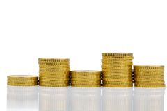 Stacked coins and downs Stock Image