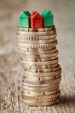 Stacked coins with houses on top Royalty Free Stock Image