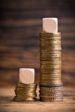 Stacked coins. Showing income difference proportion between rich and normal incomes Royalty Free Stock Images