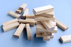 Stacked and Collapsed on Wood Blocks. Business concept, building a business. Stacked and Collapsed on Wood Blocks stock photography