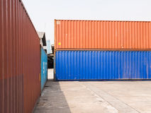 Stacked color cargo containers. Awaiting transportation royalty free stock photo