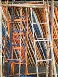 Stacked colored metal scaffolding. Stock Photography
