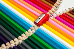 Stacked colored pencils and sharpener Royalty Free Stock Image