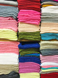 Stacked colorful fabrics in the shop. Royalty Free Stock Images