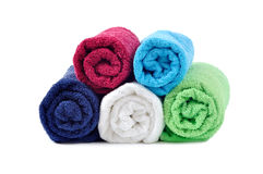 Stacked colorful rolled towels. On white background Stock Photo
