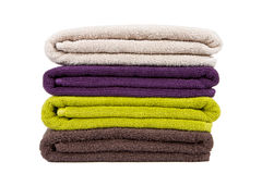 Stacked colorful towels. On a white background Stock Image